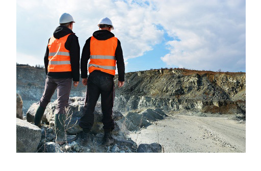 39542673 - two workers and quarry in background